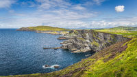 Large panorama with Kerry Cliffs and blue coloured Atlantic Ocean, Ireland