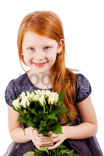 Beautiful little girl with bouquet for Mom or Father