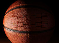 Closeup of a basketball with a tournament bracket