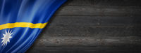 Nauru flag on black wood wall banner