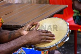 Brazilian samba performance with musician playing tambourine