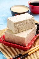Soy curd (tofu) in a ceramic bowl.