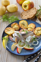 Herring fillets with baked potatoes