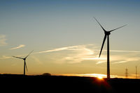 Sunrise behind a windfarm in Cornwall