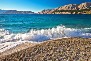 Baska. Idyllic pebble beach with high waves in town of Baska