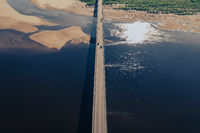 Aerial view of bridge over river in sunset light