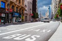 Busy street scene in Gran Via Avenue in Madrid