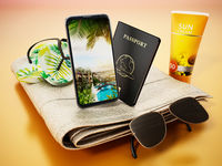 Slippers,sun screen tube, smartphone and sunglasses standing on beach towel. 3D illustration