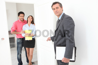 Couple eagerly waiting to sign a contract