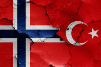 flags of Norway and Turkey painted on cracked wall