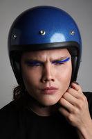 Attractive motor biker in blue helmet mockup set. Vertical headshot.