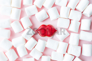 Gingerbread cookies lips with white marshmallow. Valentine card. Pink background