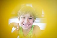 Boy smiling looking into camera closeup