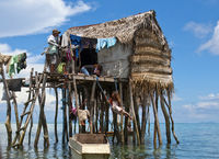 2 little girls play on the swing under the floating house