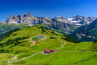Landscape of mountains of Alps in summer with green meadow in Portes du Soleil, Switzerland, Europe