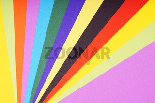 multicolored sheets of paper in fan-shaped pattern background