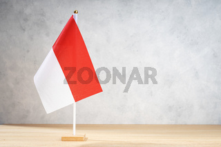 Indonesia table flag on white textured wall. Copy space for text, designs or drawings
