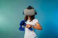 Teenager girl using a gaming gadget for virtual reality