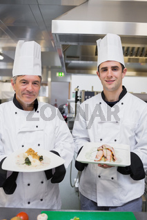 Smiling Chef's presenting their dishes