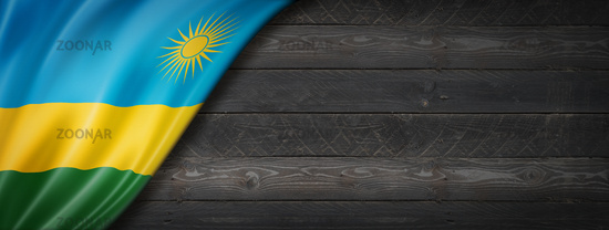 Rwanda flag on black wood wall banner