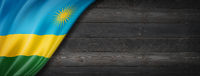 Rwanda flag on black wood wall banner
