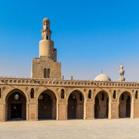 Minaret of Ibn Tulun Mosque, and dome and minaret of Amir Sarghatmish mosque, Cairo, Egypt