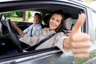 car driving instructor and woman showing thumbs up