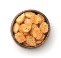 Top view of wheat croutons in wooden bowl