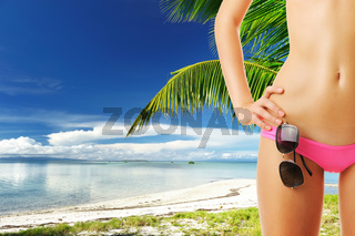 Woman with beautiful body at beach