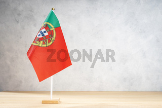 portugal table flag on white textured wall. Copy space for text, designs or drawings