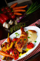 Rustic fried chicken legs with assorted vegetables and rice