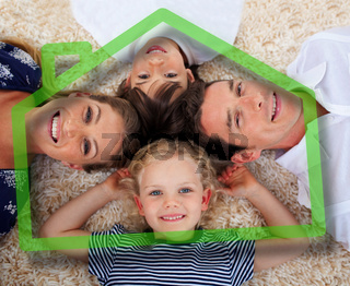 Smiling young family in front of green house illustration