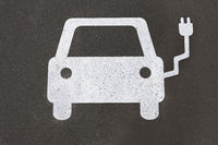 electric car charging station symbol painted on asphalt - e-mobility concept