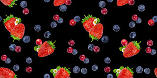 Seamless pattern of flying berries isolated on black background