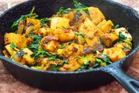 Saag Aloo, Indian style spinach and potatoes in cast iron pan