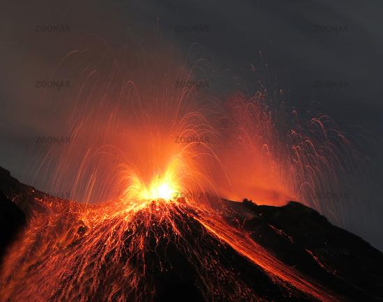 Volcano Stromboli erupting at night