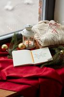 sketchbook, christmas lantern, sweater, fir branch