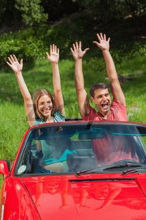 Crazy couple having fun in their cabriolet