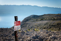 Direction sign - difficult route on mountain track on Kamenjak in Island of Rab
