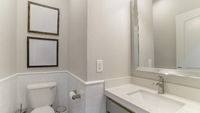 Pano Interior of a bathroom with built-in sink with cabinet and mirror