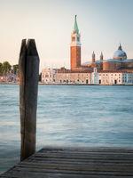 Venice lagoon, pier andisola with san giorgio maggiore church