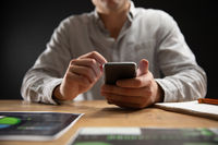 Caucasian man using a smartphone