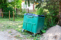 Green plastic garbage container at the outdoors