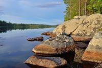 Karelian landscape - rocks, pine trees and water. Lake Pongoma, Northern Karelia, Russia