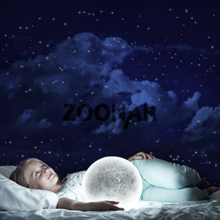 Girl in her bed and moon planet