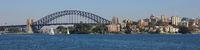 Sailing boats under the Sydney Harbor Bridge.