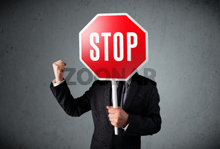 Businessman holding a stop sign