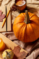 pumpkins, diary, pencil, autumn leaves and candles