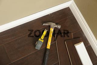 Hammer, Laminate Flooring and New Baseboard Molding
