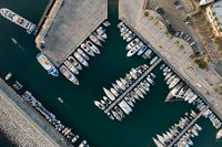 Aerial view of fishing boats and tourist yachts moored at the marina. Latsi harbor Paphos Cyprus